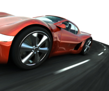 Red Sports car on curved road.